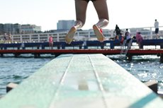 Child jumping off a springboard