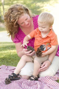 Mother with son looking at pinecones